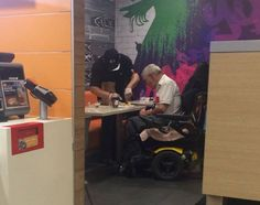 Chicago McDonald's employee helps disabled man eat his meal in viral photo
