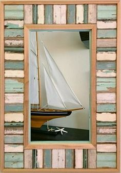This reclaimed wood frame mirror measures 36 x 25 and is beautifully handcrafted from wood from old beach homes from along the Florida