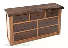 Our solid wood dresser with live edge top is proudly made in our workshop using the finest of materials and old world craftsmanship. The body of the dresser is crafted from solid alder and finished in one of our stain options. The drawer fronts are also solid wood and stained to contrast the lighter colored