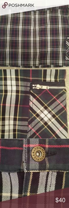 Tommy Hilfiger Plaid Mini Skirt, Sz 24 Gorgeous multi colored plaid Tommy Hilfiger Mini Skirt with zippered side pocket on bottom hem. Super cute even for the colder months. Throw on a chunky knit sweater...tights and some cute ankle booties! Size 24 Women. Excellent condition. No trades please. Tommy Hilfiger Skirts Mini