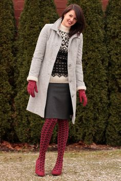 Chunky knit sweater, gray skirt and awesome red tights.