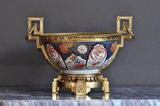 Imari bowl with gilt-ormolu stand and handles.