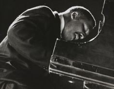 image of Bud Powell 	  Lisette Model (artist)  American, 1906 - 1983  Bud Powell, 1956-1958  gelatin silver print  sheet (trimmed to image)   I like the angle that this is taken from and that the hands are not shown.