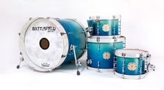 Turn one of those aerial toms into a floor tom and I'm in. http://battlefielddrums.com/gallerys/light-to-dark-teal-satin-stain-fade