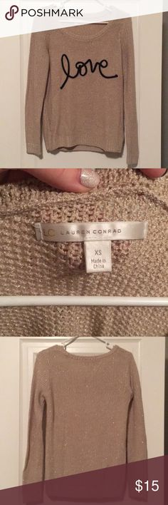 Sparkly gold love sweater By Lauren Conrad. Hardly worn, cute sparkly sweater. Not itchy!! Great condition. LC Lauren Conrad Sweaters Crew & Scoop Necks