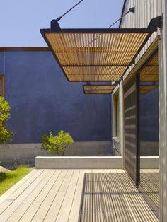 Exterior Sun Shade. Plaster wall.Santa Ynez House / Fernau + Hartman Architects