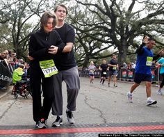 This is what love in the face of adversity looks like.  In the final stretch of a half marathon, Monique Koll's boyfriend helps her ditch her wheelchair and cross the finish line.