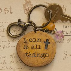 """Cross Junk Market Token Keychain - Junk Market Token copper keychain with """"I can do all things"""" and cross engraved. Blue and orange charms attached."""