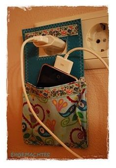 :) Cell phone outlet holder
