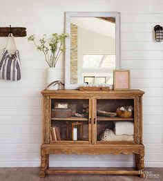 A Craigslist cabinet can be given new life with a quick sanding. Keep your wood furniture bare for a rustic look, or paint with a high-gloss finish for a bold statement. Replace glass doors with chicken wire and add vintage pulls for flea market flair.