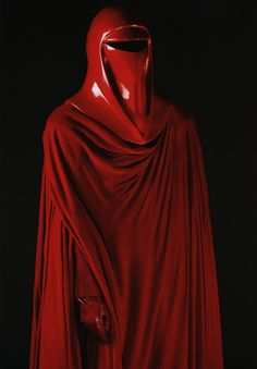 Emperor's Royal Guard Costume (Return of the Jedi): The guards' red color was used to break up the monotony of the dark production design on the set pieces where the Emperor appeared, such as the Death Star's docking bay and throne room. (Taken from Star Wars Costumes: The Original Trilogy.)