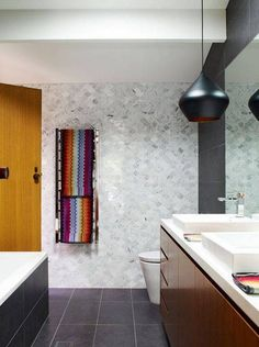 fish scale tiles bathroom with gray tile walls