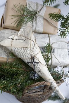 wrapping with newspaper, twine and sprigs