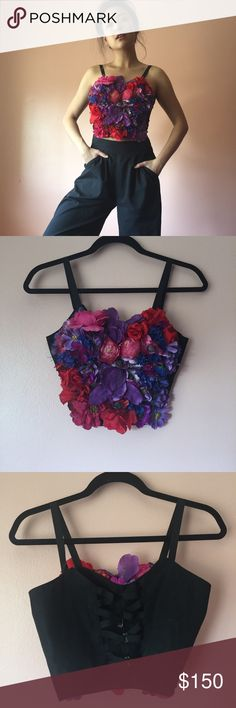 Vintage Silk Flowers Bustier Grow your garden in this insane vintage floral bustier. Features black spaghetti straps, silk roses, violets, peonies, irises, and more, black back, zig zag silver hook closure. Wear with high waisted trousers or layered over an oversized blouse. Fits like an XS/S. Missing one closure. No returns allowed. Please ask all questions before buying. Follow IG: [at] jacqueline.pak for sneak peeks, first dibs, giveaways and discount codes. #vintage Vintage Tops