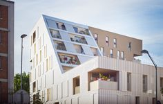 chartier dalix architectes ARC-30 social dwellings gevel volume dakvolume dak appartementen wit textuur materialisatie
