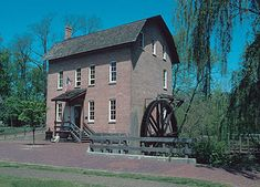 John Woods Mill (1876) with overshot water wheel now museum in Deep River County park in Hobart, Indiana
