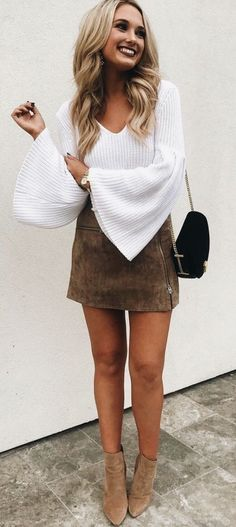 Brown suede skirt with white blouse.