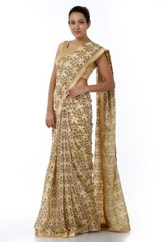 A lavishly crafted sari, fashioned in kosa silk blended with cotton in yellow colour tone. This designer creation features dense foliage of floral patterns cascading the silhouette all over. It comes with a complimenting blouse piece. This sari is also available in red floral pattern.