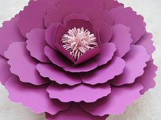 Create your own beautiful flowers with this amazing template. Purchase includes 9 different petals sizes, three different size circles, and links to videos and posts to help you get started on making beautiful paper flowers. Flowers can range from 18-7. VIDEOS can be found on my