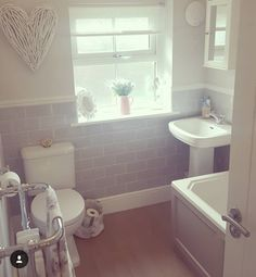 Cottage Bathroom with traditional suite and radiator. Metro Tiles Bathroom, Grey Bathrooms, Small Bathroom, Bathroom Ideas, Bathroom Taps, Bathroom Closet, Bathroom Inspo, Bathroom Organization, Budget Bathroom Remodel