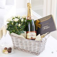 Champagne Gift Basket - a bottle of champagne, a box of chocolates and some beautiful potted roses - who wouldn't love this gorgeous gift? Holiday Gift Baskets, Themed Gift Baskets, Diy Gift Baskets, Gift Hampers, Xmas Hampers, Wine Gifts, Food Gifts, Craft Gifts, Champagne Gift Baskets