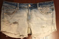 24 Popular DIY Fashion Projects-- Cut an old pair of jeans into shorts, distress, bleach and add studs!!