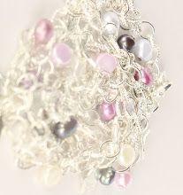Beautiful bracelets with freshwater pearls band pendants.