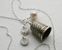 :: Crafty :: Button :: Beautiful charm necklace made using an antique 1902 fully hallmarked sterling silver thimble and milk glass buttons - by EPG in Chester, England, UK.