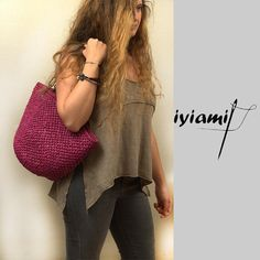 Handmade straw bag ,in  fuchsia color with brown leather straps