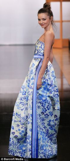Inspiration from China: The model was also seen dressed in a floor-length dress with a blue and white print that appeared to have been inspired by Ming vases