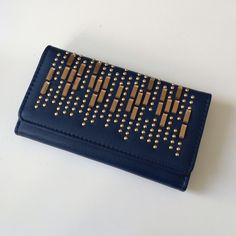 """LAST ONE!! Navy blue bling wallet Navy blue bling wallet Measures: 8"""" long/ 4.5"""" tall NWT. The inside has three billfolds, 10 card slots, and one zippered pouch. Magnetic closure. Available in black, blue, red, dark brown, and light brown.  Availability- 1 PLEASE do not purchase this listing. Price is firm unless bundled. No tradesHP by helloagainshop CLEARANCE PRICE!! ORIGINALLY $24!!! Boutique Bags Wallets"""