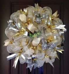 A personal favorite from my Etsy shop https://www.etsy.com/listing/485773217/silver-and-gold-wreath-wall-decor
