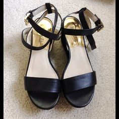 Michael Kors Leather Sandals These are in very good condition.  They were only worn twice. Doing some Spring cleaning and have quite a shoe collection. Michael Kors Shoes Sandals