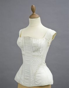A SET OF CORD QUILTED STAYS   EARLY 19TH CENTURY   white cotton with embroidered detail