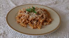 Fusilli with tomato sauce and dried porcini