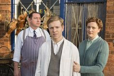 I love Miriam's slipped-stitch rib cardigan! - Claire Price as Miriam Brindsley, Daniel Ryan as Bryn Brindsley and Will Attenborough (centre) as David Brindsley in Home Fires