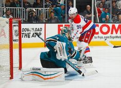 San Jose Sharks goaltender Antti Niemi makes a save on Marcus Johansson of the Washington Capitals (Feb. 11, 2015).
