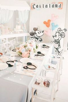 Don't a look at this gorgeous vintage DIsneyland-themed birthday party! Love the table settings! See more party ideas and share yours at CatchMyParty.com