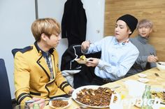 Though his noodle is delicious, the one given by the member is more delicious. V is giving the black noodle into JUNG KOOK's mouth. The pickled radish on top symbolizes V's love for him.