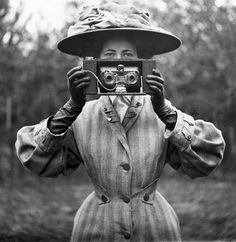 Women who shoot.-  Lovely image.  Looks like a stereo autographic camera --I think.
