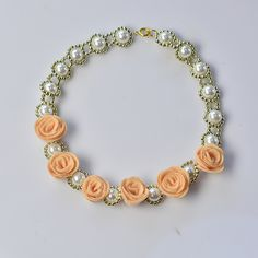 final look of the pearl flower necklace with felt flowers
