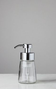 Small Foaming Soap Dispenser features a refillable clear glass base and metal foam pump with chrome finish. Fill and refill with your favorite foaming soap and sit sink side for a beautiful touch. Kitchen Soap Dispenser, Glass Dispenser, Soap Dispensers, Metal Foam, Glass Spray Bottle, Liquid Hand Soap, Soap Pump, Faucet Handles, Schaum