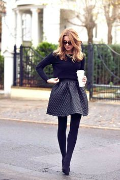 Shop this look for $111:  http://lookastic.com/women/looks/statement-necklace-and-crew-neck-sweater-and-full-skirt-and-tights-and-heels/1183  — Gold Statement Necklace  — Black Crew-neck Sweater  — Black Quilted Leather Full Skirt  — Black Tights  — Black Suede Heels