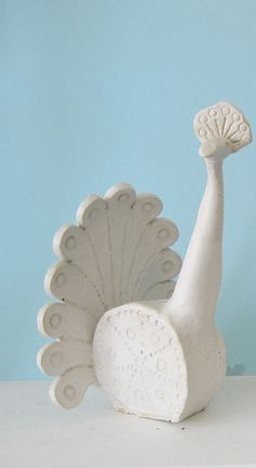 Mid Century Peacock - make with sculpty clay....have students create stoneware animal forms with multiple hand building techniques-simplifies details/abstract?