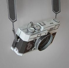 How to Make a Papercraft camera. click on link and go down page to see free template and download. http://paper-design.wonderhowto.com/how-to/make-papercraft-rolex-watch-0128092/