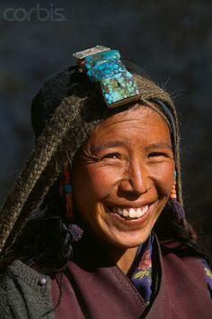Nepal | Woman Wearing a Chule, a Traditional Turquoise Headdress | © Christophe Boisvieux/Corbis