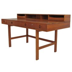Danish Lovig Teak Desk by Jens Quistgaard | From a unique collection of antique and modern desks and writing tables at http://www.1stdibs.com/furniture/tables/desks-writing-tables/