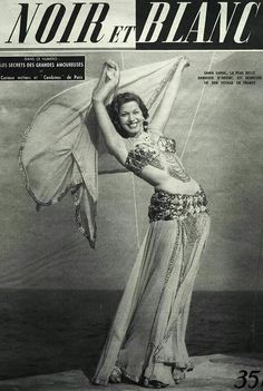 "The egyptien belly dancer ""Samia Gamal"" featured on the cover of the French magazine Noir et Blanc, October The caption on the cover reads: ""Samia Gamal, the most beautiful oriental dancer, is enjoying her trip to France. Dance Oriental, Divas, Vintage Dance, Bollywood, Zeina, Tribal Belly Dance, Dance Pictures, Dance Pics, Dance Art"