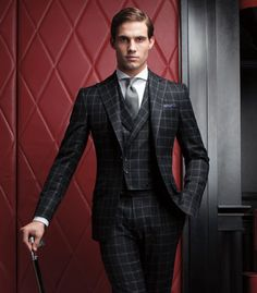 Well tailored windowpane suit.
