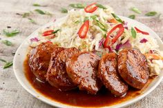 You asked for this customer favorite to make a comeback and we delivered! In this tasty Korean dish, Sriracha-marinated pork tenderloin medallions are paired with a tangy slaw, sweet soy and garlic marinade, crunchy peppers, and green onions to create a fresh, inspired dish that won't weigh you down. You'll feel like an accomplished chef and champion eater in no time at all.